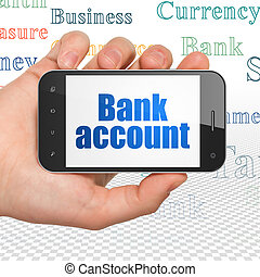 Money concept: Hand Holding Smartphone with Bank Account on...