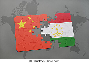 puzzle with the national flag of china and tajikistan on a...