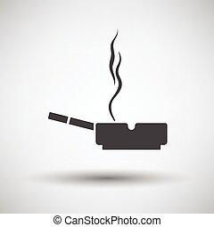 Cigarette in an ashtray icon on gray background, round...