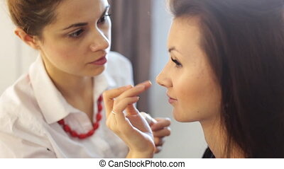Make-up artist doing make up for young girl - Make-up artist...