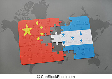 puzzle with the national flag of china and honduras on a...