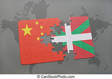 puzzle with the national flag of china and basque country on a world map background.