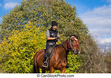 Elegant attractive woman riding a horse meadow - Elegant...