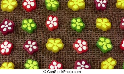 Colorful candies on brown background