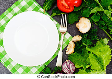 Fresh Spring Vegetables, Greens and Empty White Plate with Place for Your Text