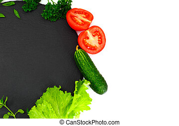 Fresh Spring Vegetables, Greens and Empty Black Plate with Place for Your Text