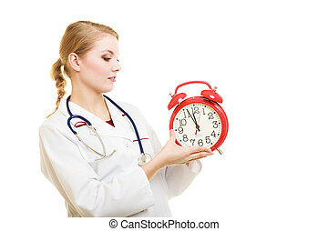 Woman doctor with clock isolated on white - Health care...