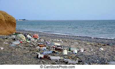 Pollution of the sea - Lots of garbage lying on the shore of...