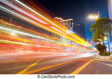 light trails on the street - the colorful light trails on...