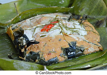 curry steamed fish in banana leaf