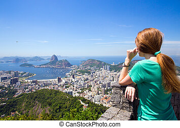 girl tourist looks at Rio landscape - girl tourist looks at...