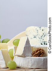 Cheese board - Various kinds of cheese with walnuts and...