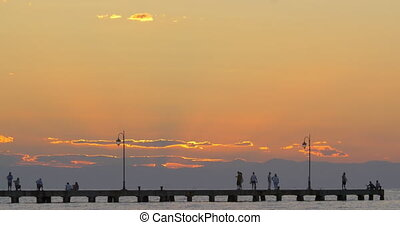 Cinemagraph - People enjoying seascape from the pier at...