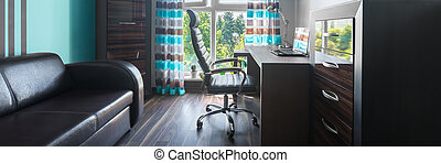 Small home office with brown furniture, leather sofa,...