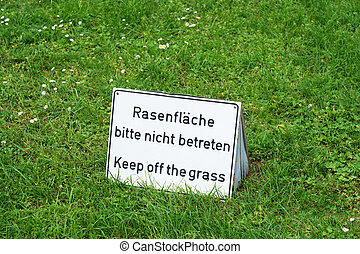 bilingual keep of the grass sign in Germany - bilingual keep...