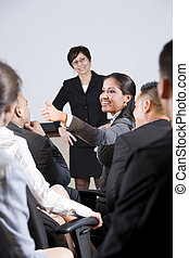 Group businesspeople, focus on woman in audience - Group of...