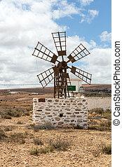 Historic wooden wind mill near the village Puerto Lajas on...