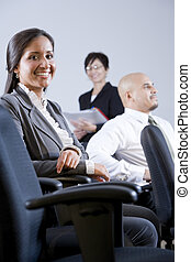 Young adult Hispanic business people in meeting - Young...