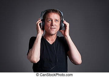 Man with a headphone - A middle age listening and enjoying...