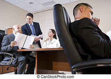 Low angle view of business meeting in boardroom