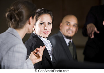 Woman listening to office colleague in meeting - Woman...
