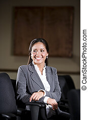 Hispanic female office worker in office boardroom