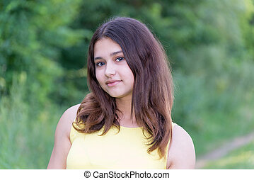 beautiful girl 14 years old posing on summer nature -...