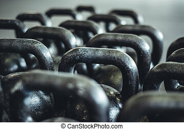 Kettlebells organized and put away at the gym.