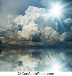 Sunbeam in the Dark Blue Clouds - Blue sunset over the sea,...