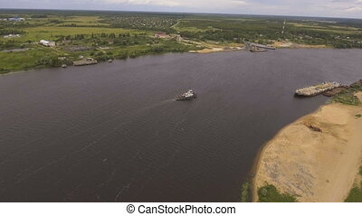 Aerial view:Tugboat on the river.