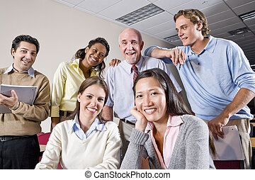 Group of college students and teacher in class - Multiracial...