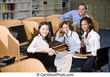University students sitting  at library computer