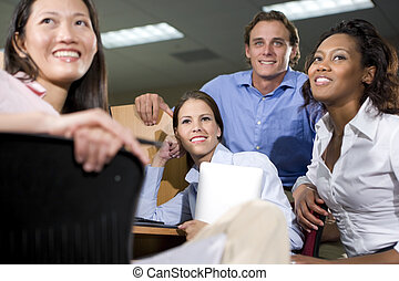 Group of college students studying together - Multiethnic...