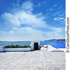 Terrace on Santorin island with a view on azure...