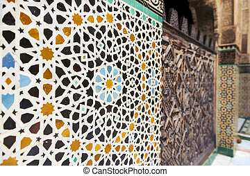 Wall ornamented with tiles - Detail of a wall ornamented...