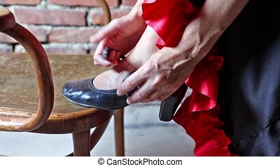 Flamenco dancer putting on shoe closeup - Closeup view of a...