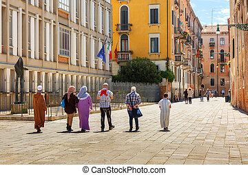 Tourists in Venice, Italy - Tourists on a typical Venetian...