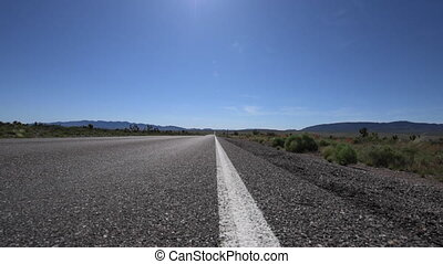 Empty Road Nevada Hwy 93 low angle tracking - Empty Desert...