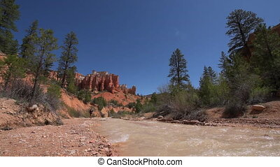 Hiking Bryce Canyon - Hiker walking alog the river towards...