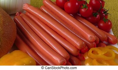 Sausages on white plate - Close up of raw frankfurter...