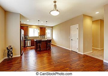 Kitchen interior with hardwood floor and beige walls. View...