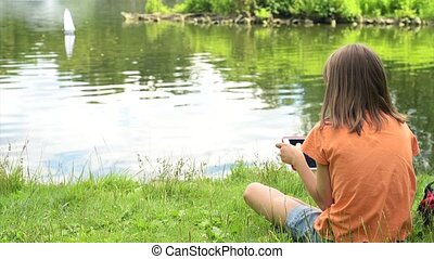 Girl with remote controlled boat - Girl playing with a...