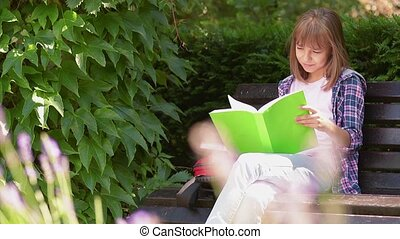 Girl reading book - Happy beautiful little girl reading book...