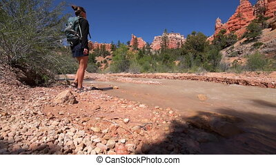 Hiking Bryce Canyon - Hiker exploring Bryce Canyon Mossy...