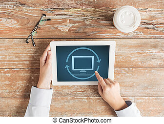 close up of female hands with tablet pc and coffee -...