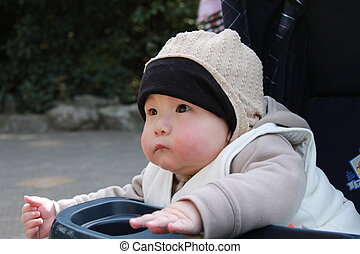 cute baby sitting in the stroller