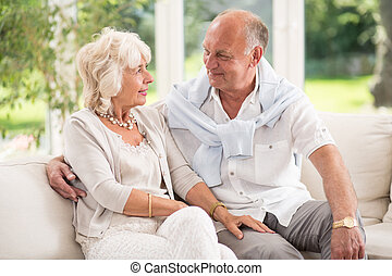 Tenderness in old age- senior happy couple in love