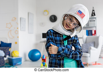 This work clothes suits me - Boy poses in a toy helmet and...