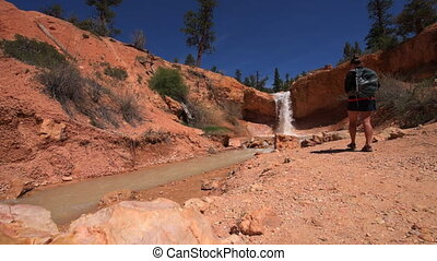 Hiking Bryce Canyon Waterfall - Hiker Girl taking pictures...
