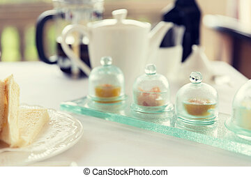 close up of tea time set with jam on table